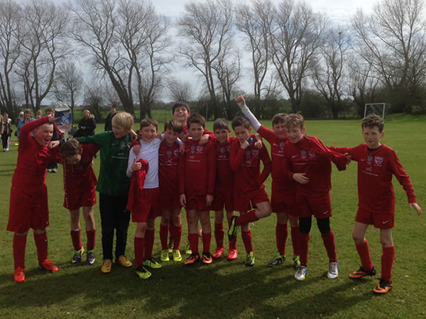 under-11s-football-team-celebrating-promotion.jpg